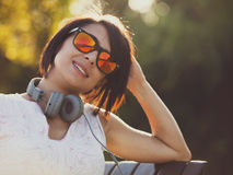 Young woman listening to music in headphones outside Royalty Free Stock Images