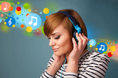Young woman listening to music with headphones Stock Photos