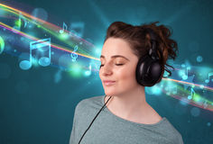 Young woman listening to music with headphones Royalty Free Stock Photography