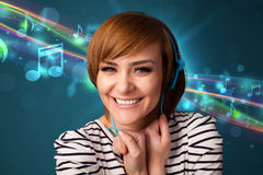 Young woman listening to music with headphones Royalty Free Stock Photo