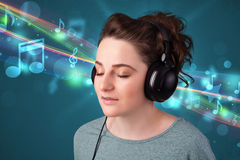 Young woman listening to music with headphones Stock Photography