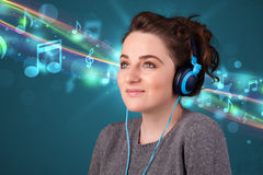 Young woman listening to music with headphones Stock Image
