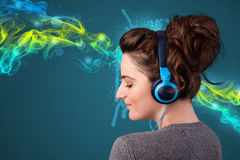 Young woman listening to music with headphones Stock Images