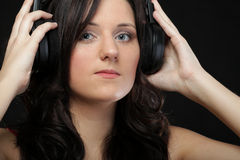 Young woman listening to music on headset Stock Photos