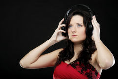Young woman listening to music on headset Stock Photo