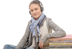 Young woman listening to music with his headphone Royalty Free Stock Photos