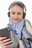 Young woman listening to music with his mobile phone Stock Photo