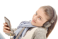 Young woman listening to music with his mobile phone Royalty Free Stock Photo