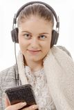 Young woman listening to music with his mobile phone Stock Image