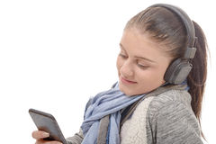 Young woman listening to music with his mobile phone and headpho Royalty Free Stock Photos