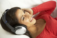 Young Woman Listening To Music At Home Stock Images