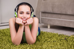 The young woman listening to music at home Royalty Free Stock Photos