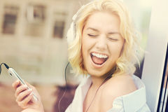 Young woman listening to music at home Royalty Free Stock Images