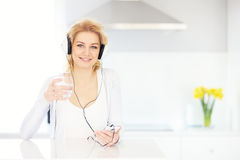 Young woman listening to music at home Royalty Free Stock Image