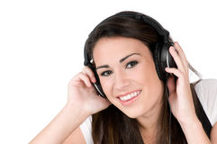 Young woman listening to music, isolated Stock Photography