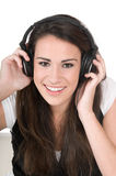 Young woman listening to music, isolated Stock Image