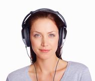 Young woman listening to music isolated over white Royalty Free Stock Photography