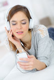 Young woman listening to music through mobile Stock Photos