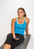 Young woman listening to music. Stock Photo