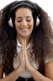 Young woman listening to music and praying Royalty Free Stock Photography