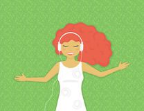 Young woman is listening to music Stock Photography