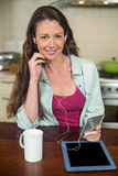 Young woman listening to music on smartphone Stock Photos
