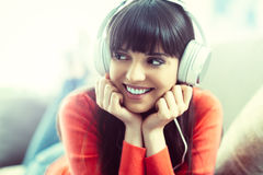 Young woman listening to music royalty free stock images