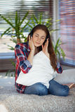 Young woman listening to music. On sofa at home Royalty Free Stock Photos