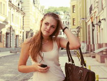 Young Woman Listening to Music Urban Scene Stock Image