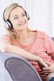 Young Woman Listening To Music On Wireless Headphones Stock Photos
