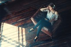 Young woman listening to music. On headphones Royalty Free Stock Image