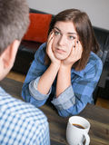 Young woman listening to partner or friend. Young woman in conversation, listening to partner or friend Stock Photography