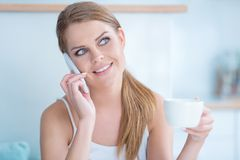 Young woman listening to a phone conversation Stock Photography