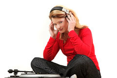 Young woman listening to record Royalty Free Stock Photo