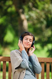Young woman listening to some music Stock Image