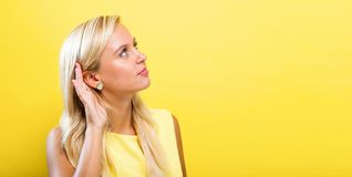 Young woman hearing something stock photos