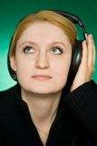 Young woman listens to music. Stock Photos