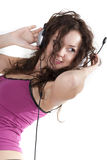 The young woman listens to music in ear-phones Royalty Free Stock Photography