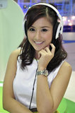Young woman listens to music on headphones Royalty Free Stock Images