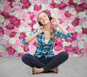 Young woman listeting to music with headphones Stock Photo
