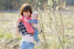 Young woman with little baby Stock Photo