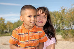 Young woman and little boy Stock Image