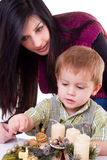 Young woman and little boy with advent wreath Stock Photography