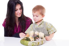 Young woman and little boy with advent wreath Stock Photos