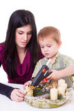 Young woman and little boy with advent wreath Royalty Free Stock Photo