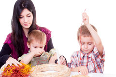 Young woman and little boys with advent wreath Stock Photo