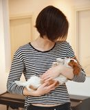 Young woman with puppy Royalty Free Stock Photos