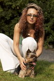 Young woman with little dog. Young woman with small yorkshire Royalty Free Stock Image