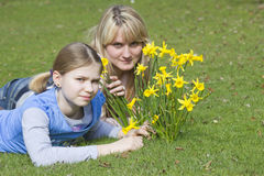 Young woman and little girl. Young women and little girl in the park on a warm spring day stock images