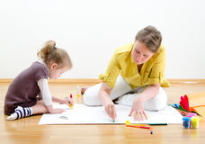Young woman and little girl drawing Stock Photo